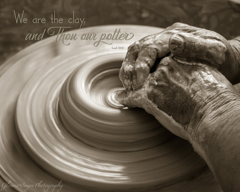 Old pottery's hand forming clay on potter's wheel with scripture verse