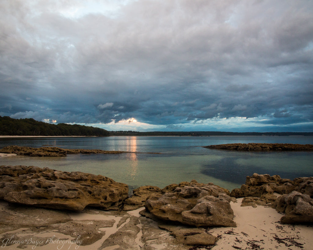 Sunset over the bay with a rocky beach in Scottish Rocks, Australia
