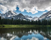 Glacier Park Lake Josephine snow on mountains clouds reflection