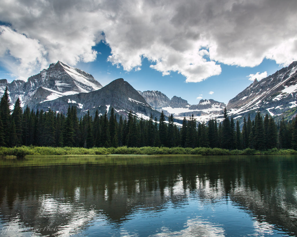 Lake Josephine in summer with snowy mountains in Glacier National Park