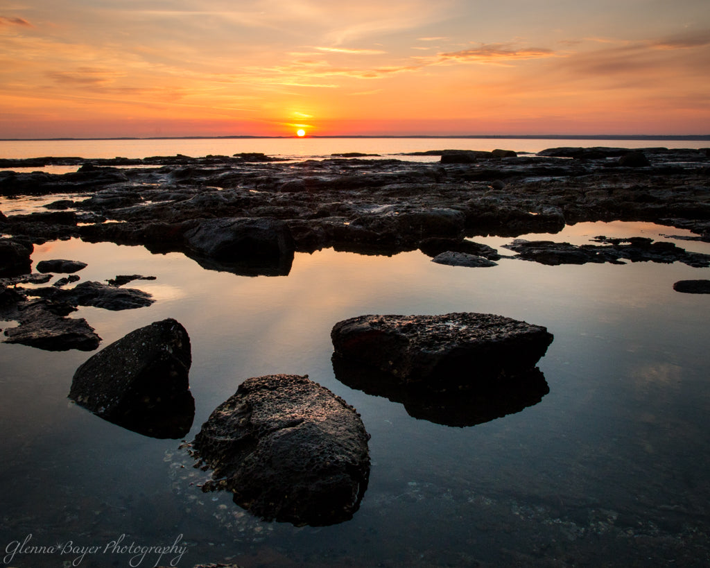 Sunset over the Jervis Bay with rocks and reflection in Australia