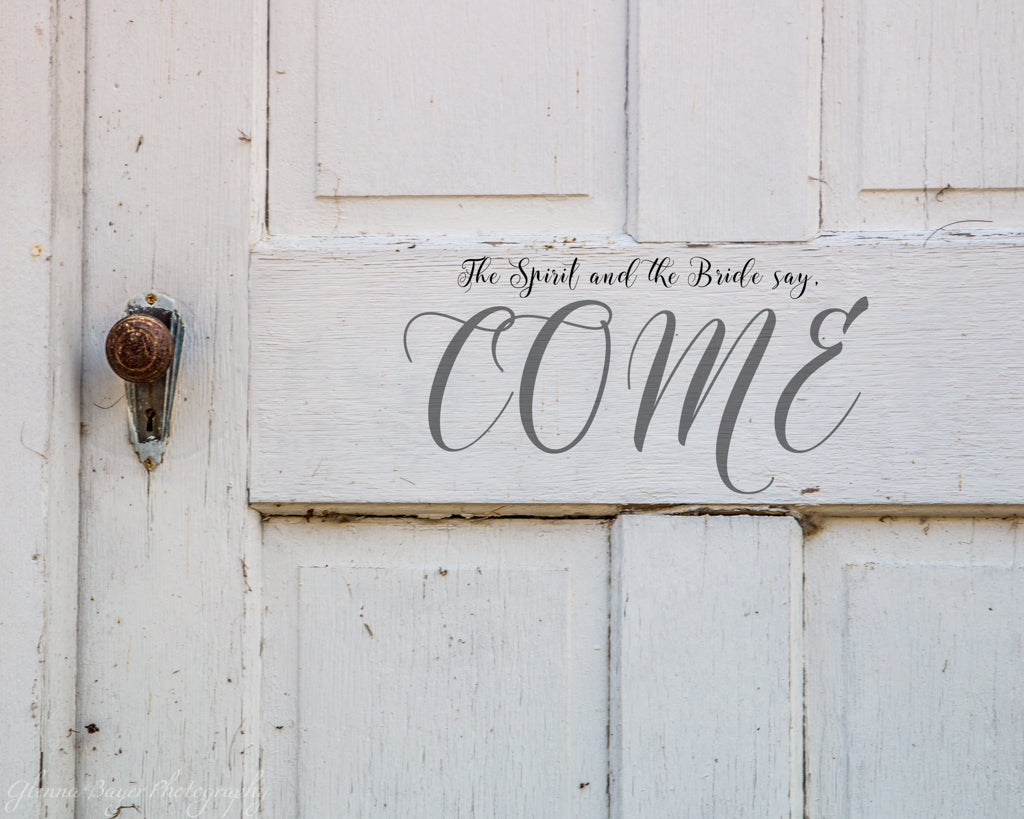 Old white church door with scripture verse