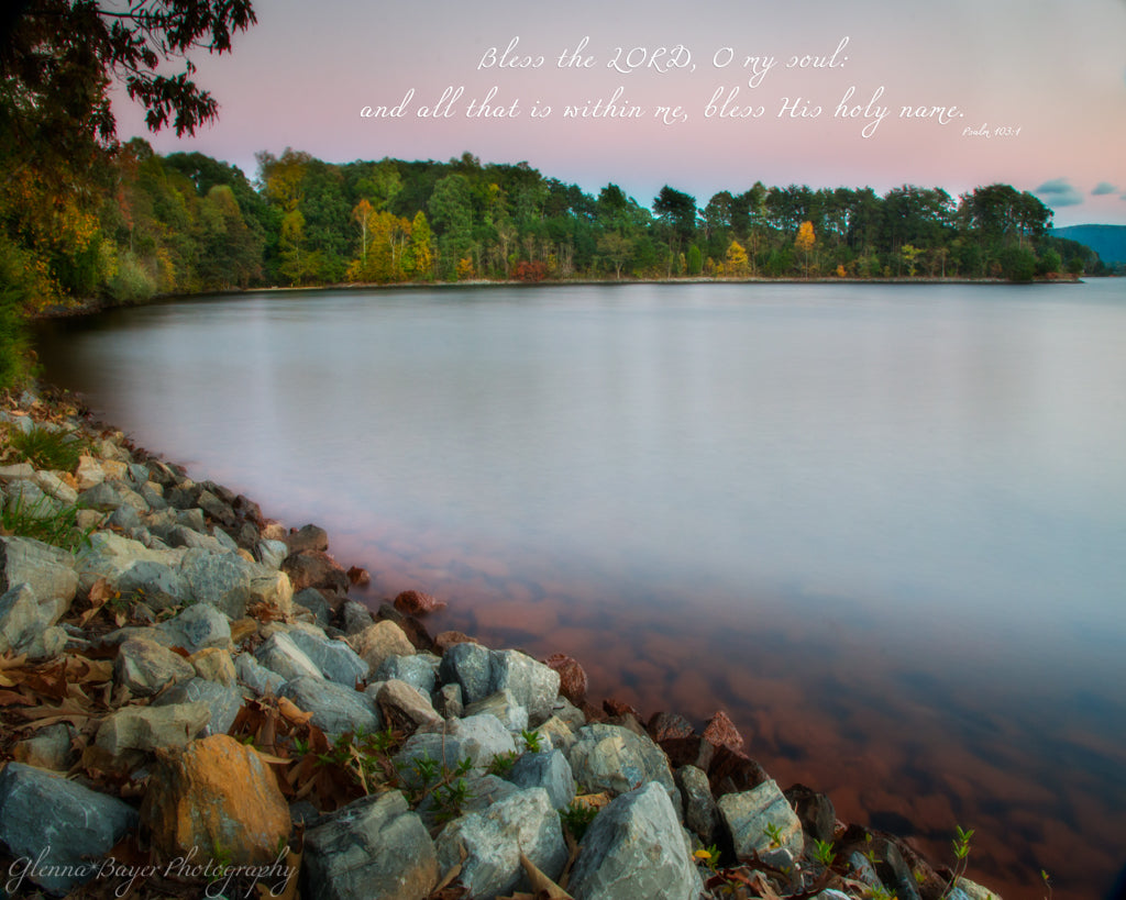 Smith Mountain Lake with rocky shoreline during sunset with scripture verse