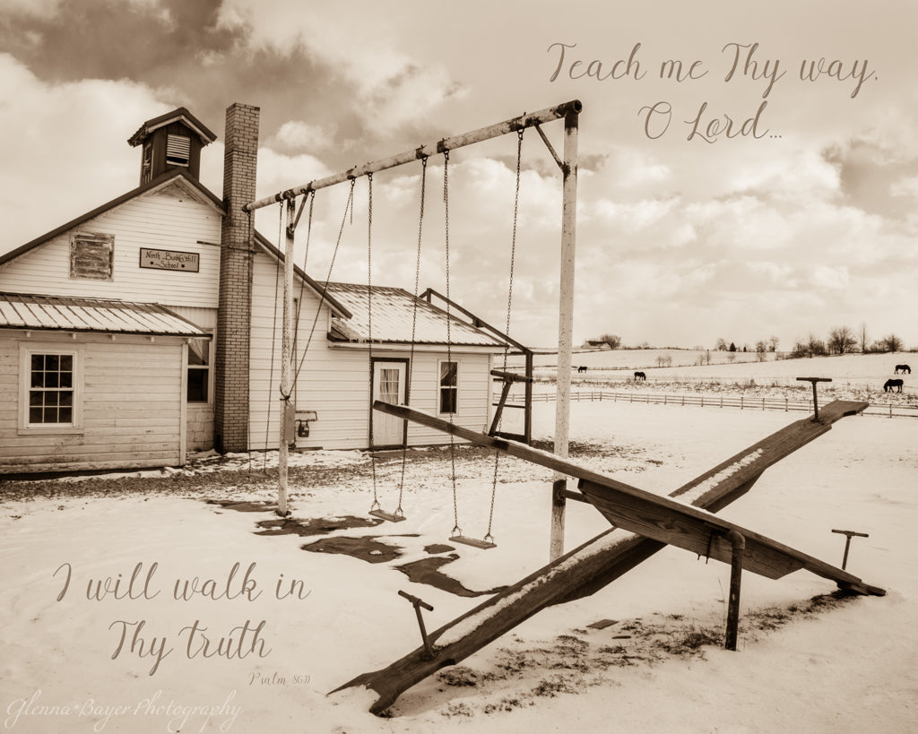 Amish schoolhouse and playground with scripture verse