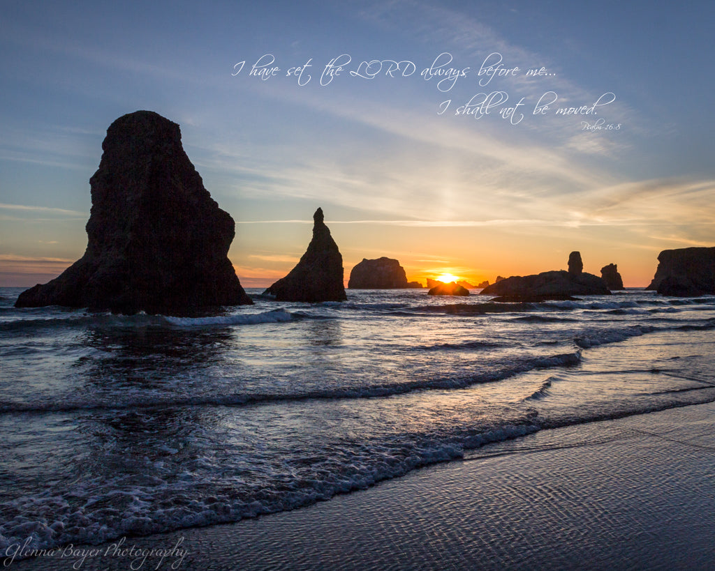 A blue, yellow sunset at Bandon Beach in Oregon with scripture verse
