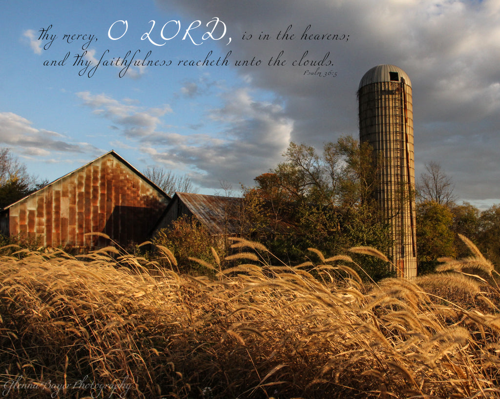 Old barn, silo, and wheat in evening light with scripture verse
