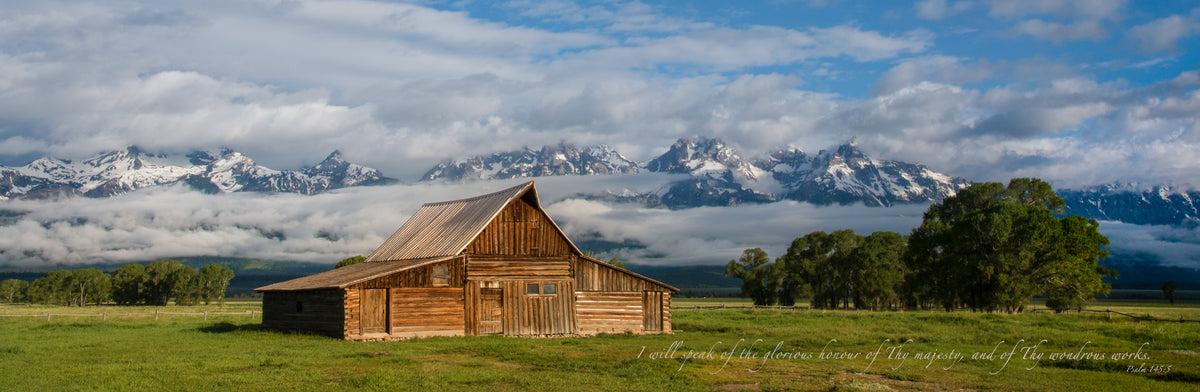 Old barn in the Great Teton mountains with a scripture verse.