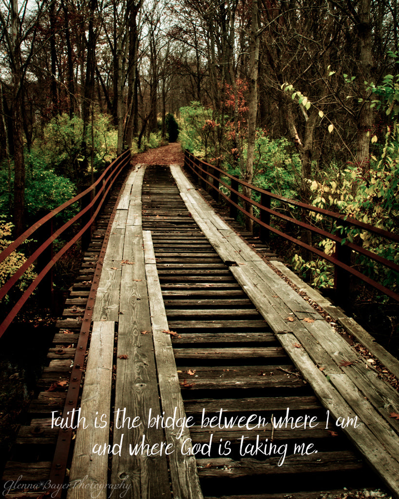 Old wooden bridge in autumn woods with scripture verse
