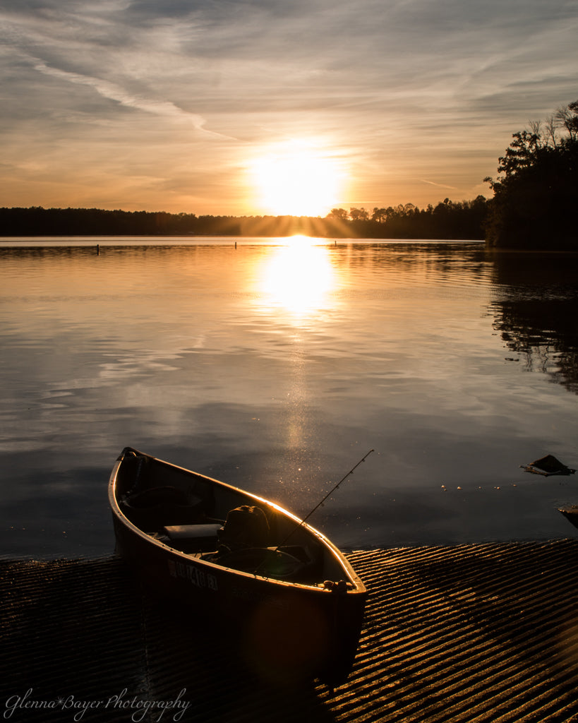 Sunset over lake and canoe at Cowman Lake in Ohio