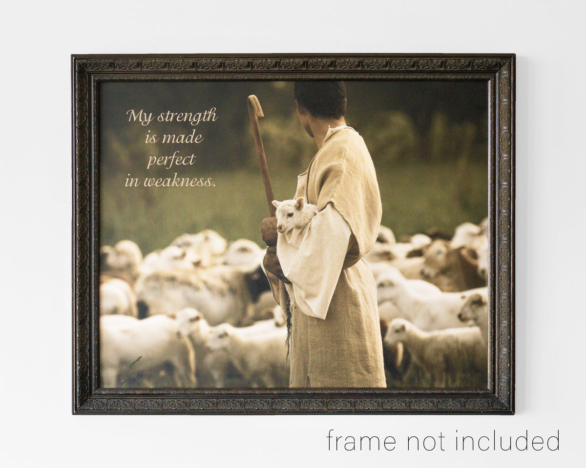 framed print of Shepherd with staff holding little lamb with flock of sheep with scripture verse