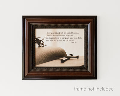 framed print of Crown of thorns and nails lying on open Bible with scripture verse