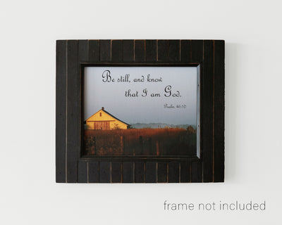 framed print of Old sunlit barn in field with scripture verse