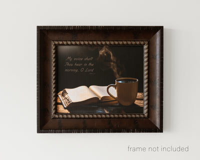 framed print of Steaming cup of coffee beside open Bible with scripture verse