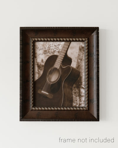 framed print of Acoustic guitar leaning against tree with scripture verse
