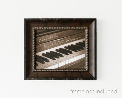 framed print of piano keys with scripture verse