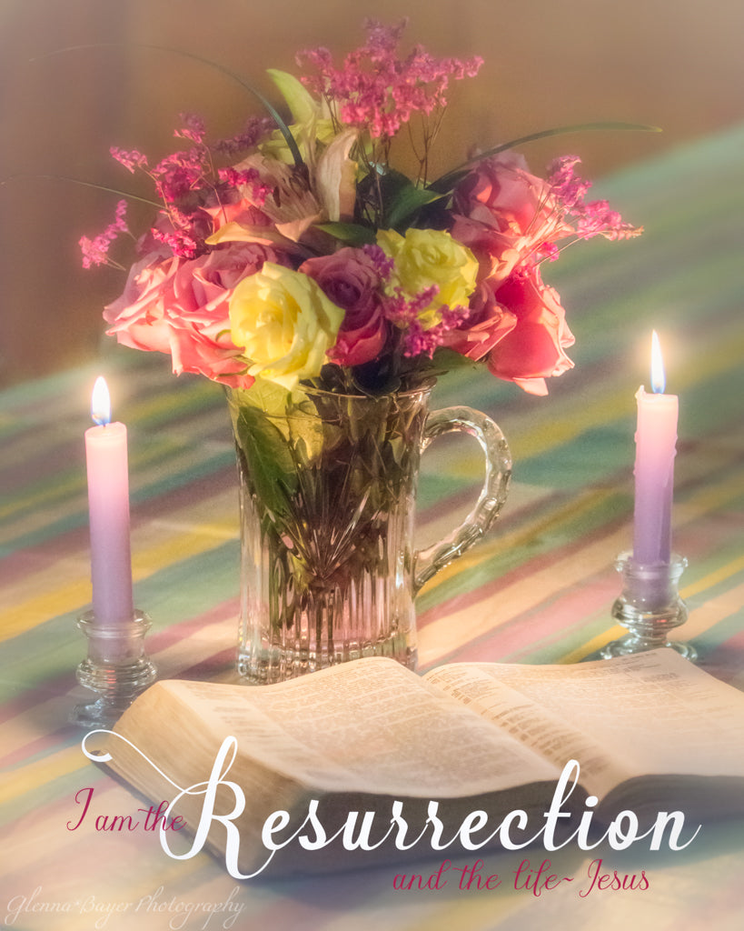 Open Bible with purple candles and pink and yellow spring flower bouquet