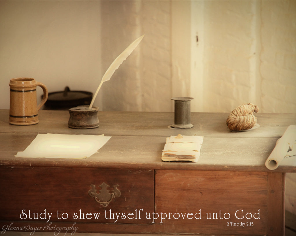 Old writing desk with paper and ink quill in Mount Vernon, Virginia with scripture verse