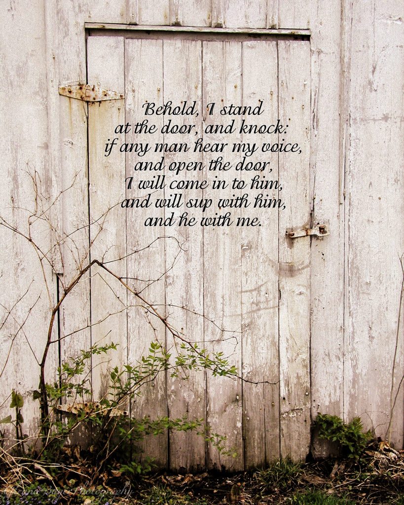 Old white barn door with scripture verse