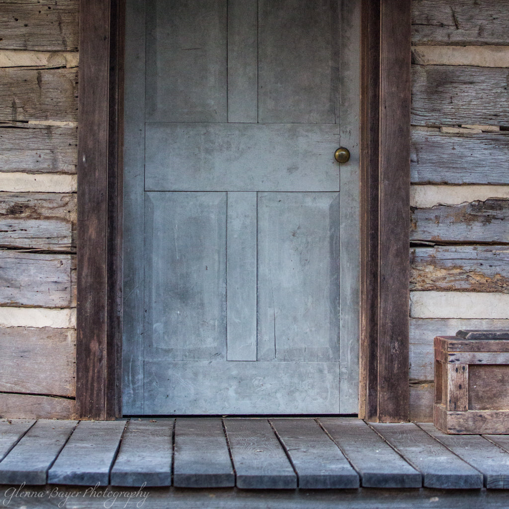 Old log cabin's gray door