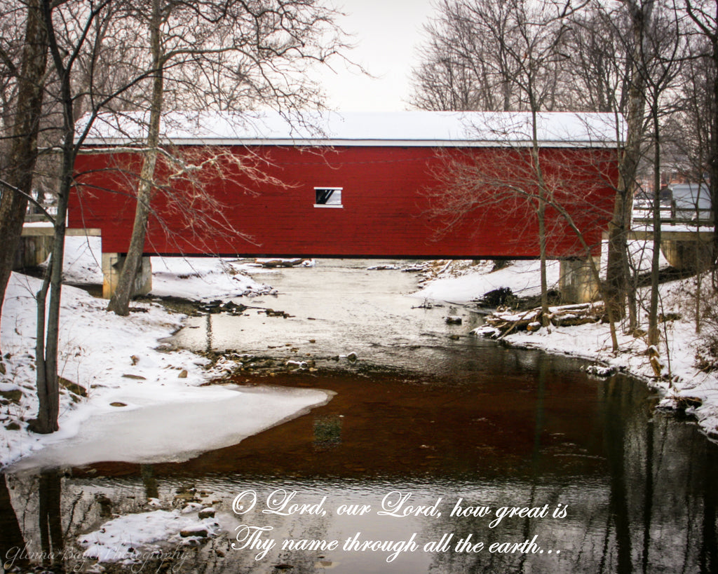 Red covered bridge during a snowy winter day in Eaton, Ohio with scripture verse