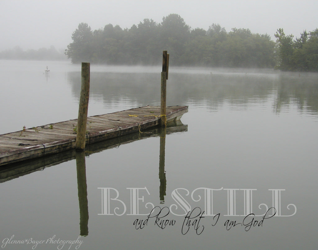 Old wooden dock over a lake on a foggy, gray morning with scripture verse