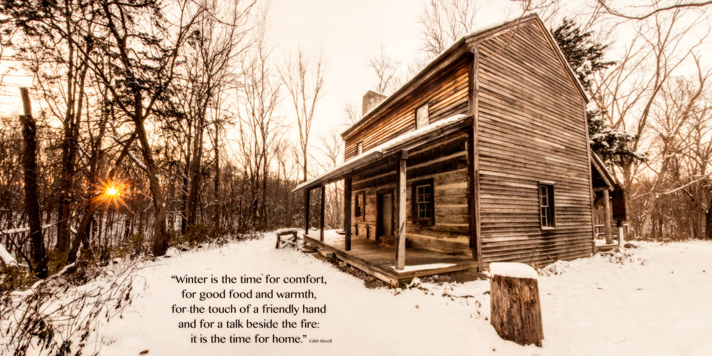 Old log cabin in winter at sunset with inspirational quote