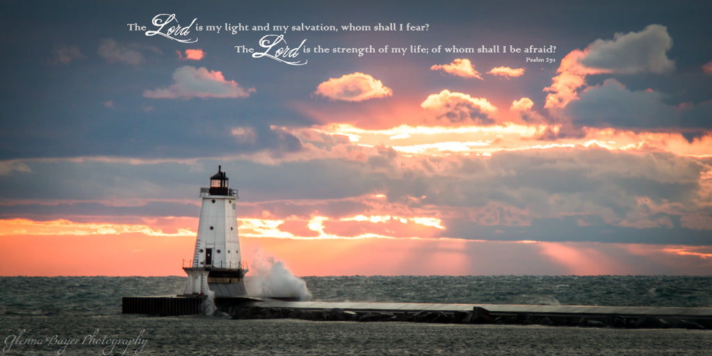 Ludington Lighthouse on Lake Michigan during sunset with scripture verse