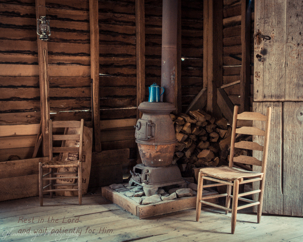 Potbelly stove and wooden chairs in the Mingus Mill in North Carolina with scripture verse