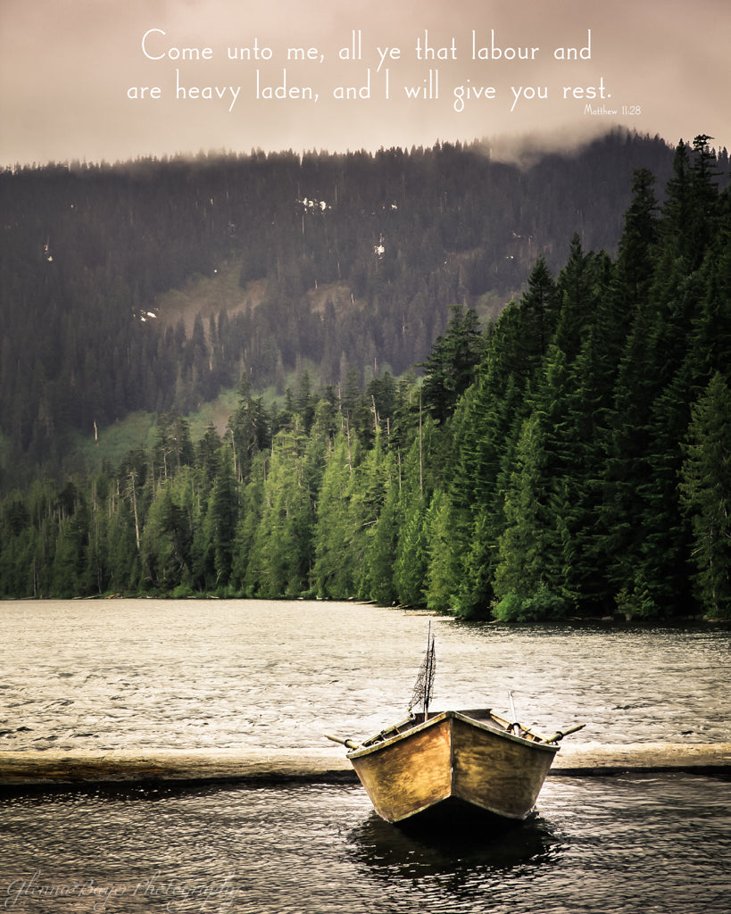 Old wooden fishing boat in Oregon lake with scripture verse