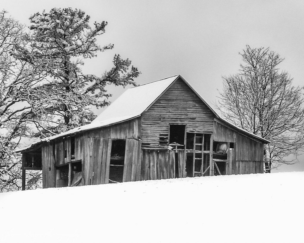 Old wood barn on hill in snow in Red Valley, Virginia