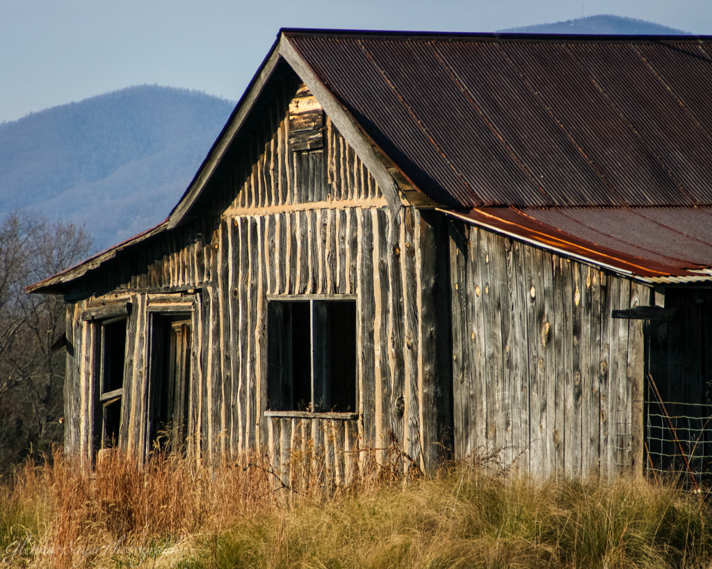 Old rustic wood barn during fall in West Virginia
