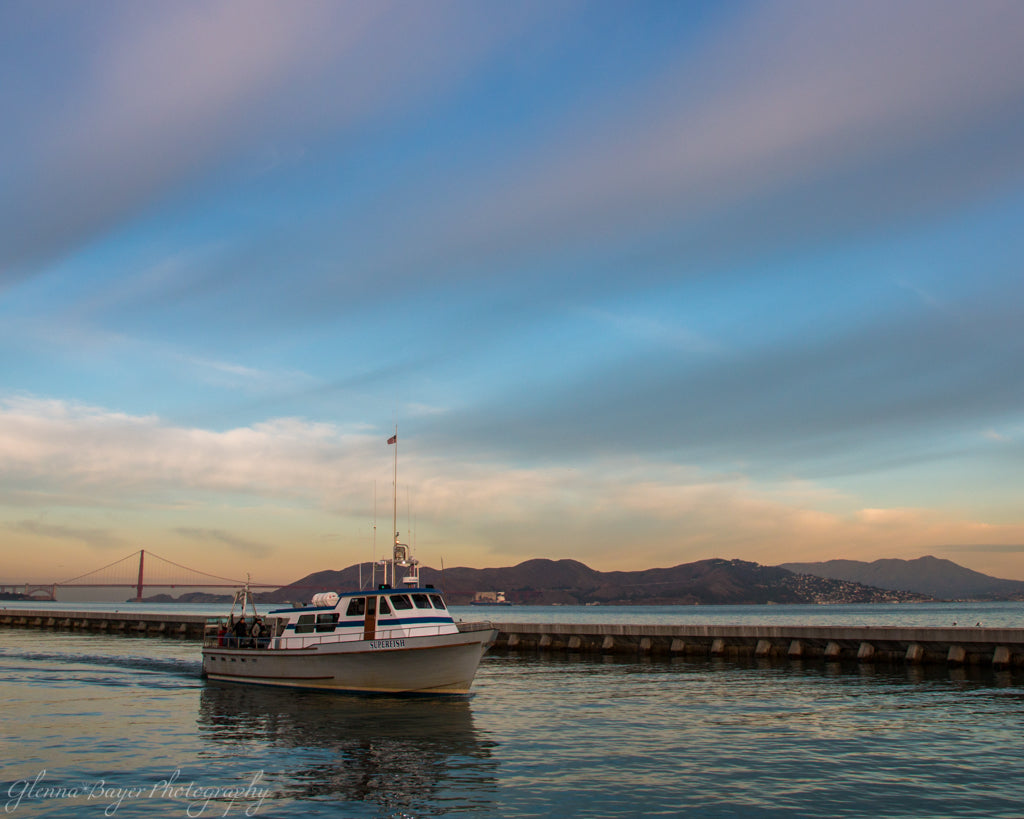 Boat in bay during sunrise in San Francisco, California