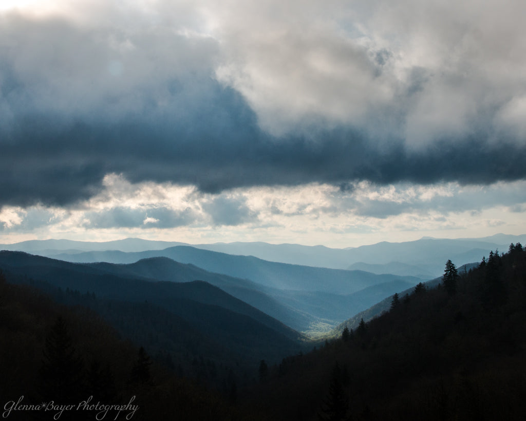 Sun shining in the Smoky Mountain valley during sunrise on cloudy day