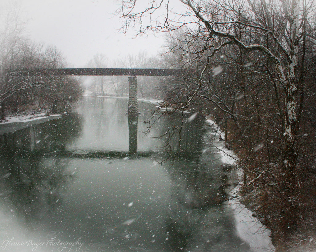 Bridge over Stillwater River in Ohio on snowy day
