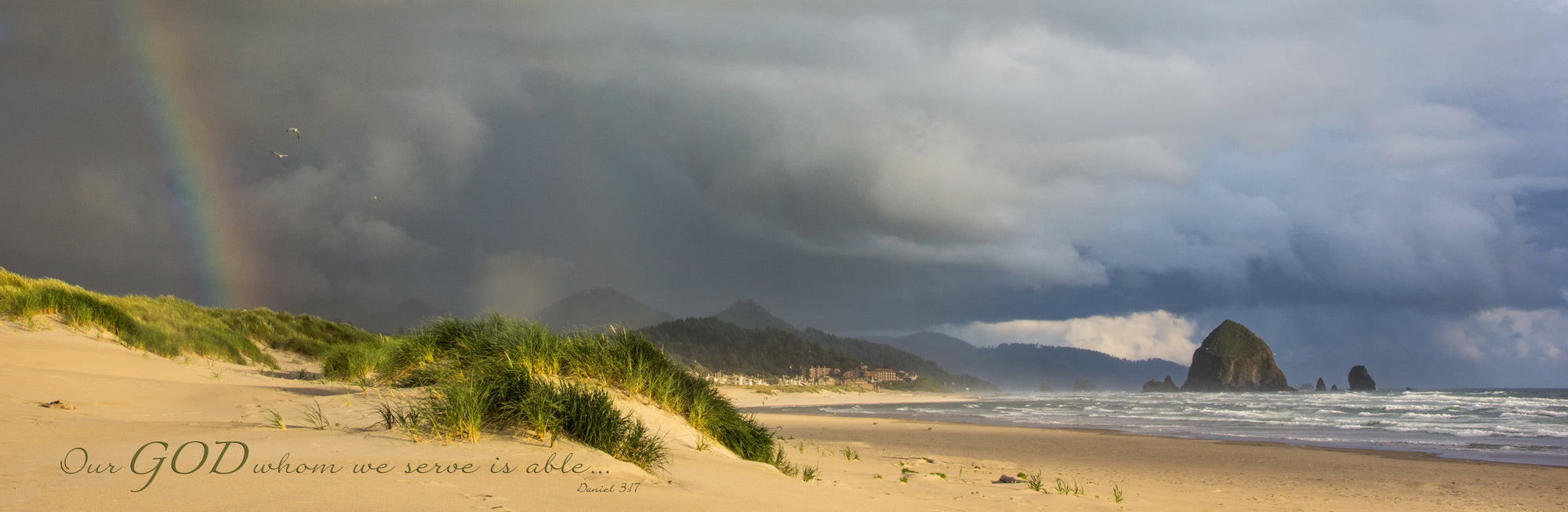 Storm and rainbow over beach at Haystack Rock, Oregon with scripture verse
