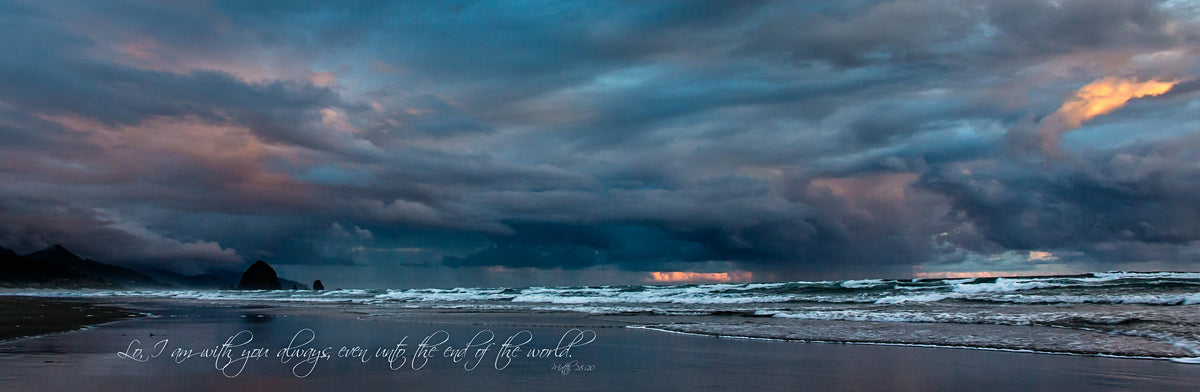 Storm over the beach at Haystack Rock during sunrise with scripture verse