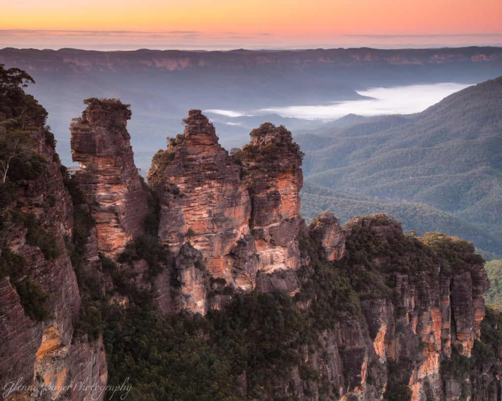 Orange sunrise over the Three Sisters, in the Blue Mountains of Australia