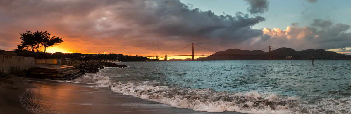 Panorama of orange and blue sunset at the Golden Gate Bridge in California