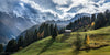 Grassy mountains and blue cloudy sky in the Swiss Alps in Murren, Switzerland