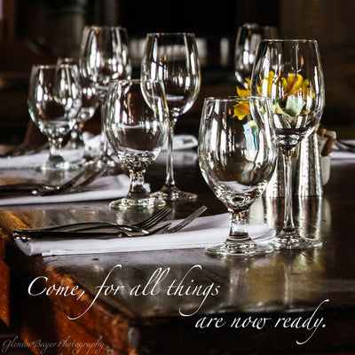 Wood table set with glass dishes at the Mount Hood Lodge in Oregon with scripture verse