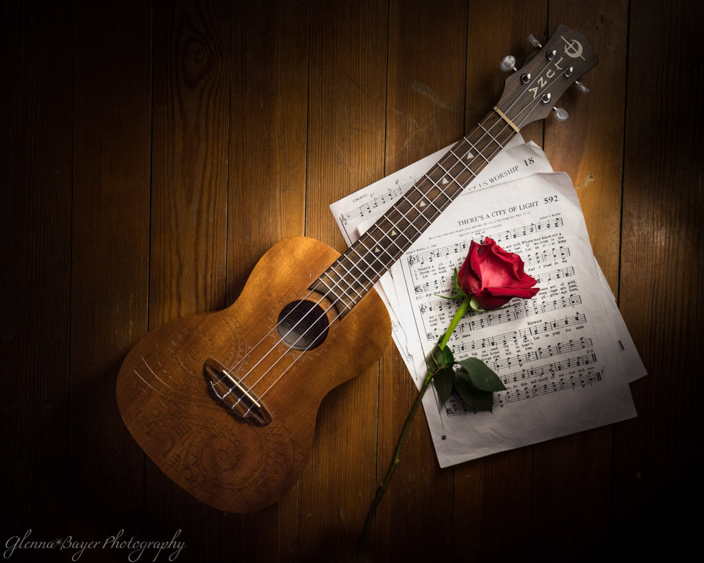 Ukelele, Music Sheet, and Rose Still Life