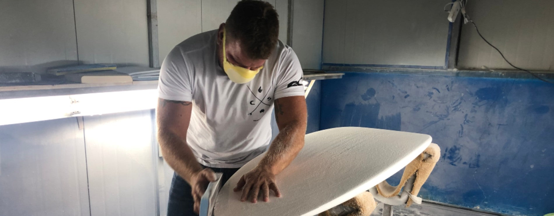 Ryan Briggs working on surfboard