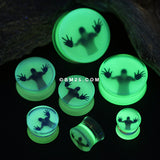 A Pair of Glow in the Dark Trapped Man Double Flared Plug