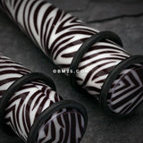 A Pair of Retro Zebra Swagg Acrylic Ear Stretching Taper-White