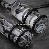 A Pair of Marble Swirl Acrylic Taper-Clear/Black
