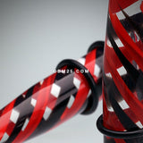 A Pair of 2-Toned Candy Swirls Taper-Black/Red