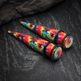A Pair of Tie Dye Rainbow Print Acrylic Ear Stretching Taper