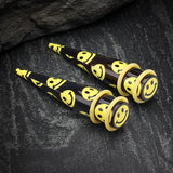 A Pair of Retro Smiley Face Acrylic Ear Stretching Taper