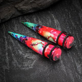 A Pair of Cosmic Burst Galaxy Print Acrylic Ear Stretching Taper