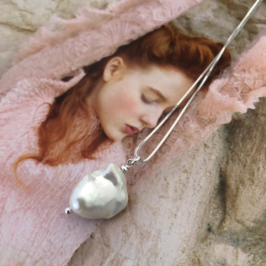 Leoni & Vonk white baroque pearl on sterling silver chain photographed on a magazine page.
